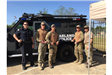 Officers Standing In Front of an Armored Truck