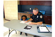 Police Officer Reading with a Kid